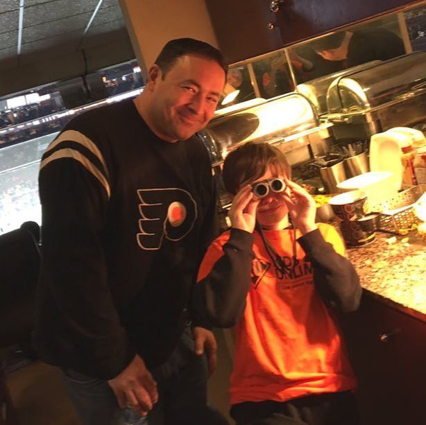 Picture of Kids Unlimited member and dad at Flyers Game