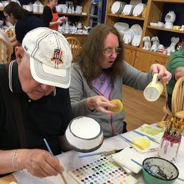 Picture of Carol at Color Me Mine painting a mug