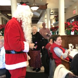 Picture of Kent dressed up as Santa at the client Holiday Party