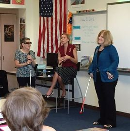 Picture of Gay speaking to a middle school class about living with blindness